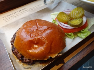 BRGR.CO Soho - Butchers Cut Burger (8 Oz) comes with salad on the side.